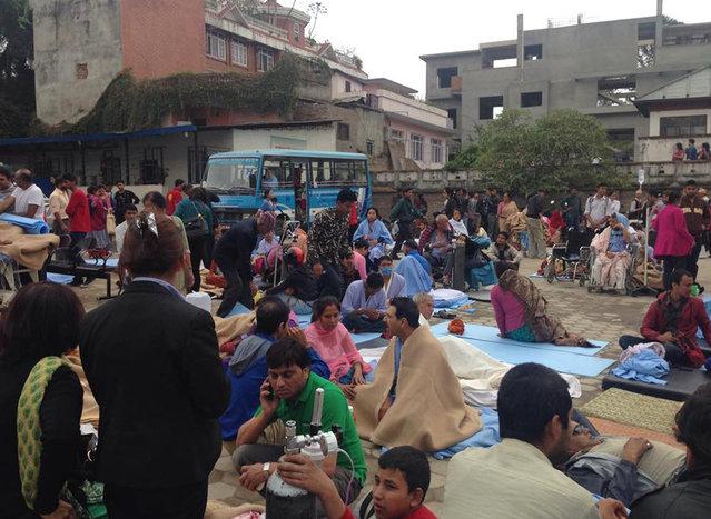Patients wait at the parking lot of Norvic International Hospital after an earthquake hit Kathmandu, Nepal, Saturday, April 25, 2015. (Photo by Binaj Gurubacharya/AP Photo)