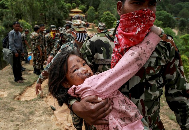 An injured girl is carried by a Nepal Army personnel to a helicopter following Saturday's earthquake in Sindhupalchowk, Nepal, April 28, 2015. (Photo by Danish Siddiqui/Reuters)