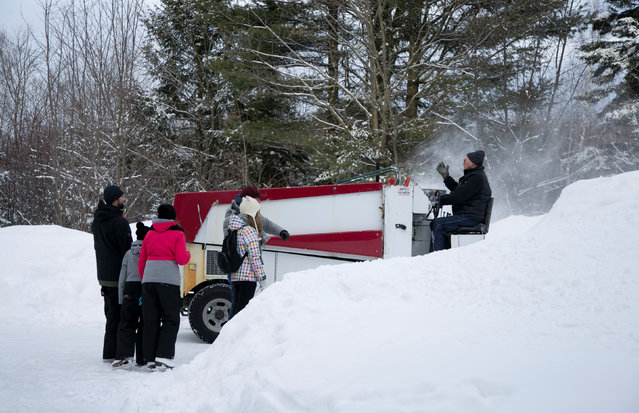 People watch as the zamboni passes on the path at Domaine de la Foret Perdu or the Lost Forest, a 15km weaving and zambonied forest trail made for skating in Notre-Dame-du-Mont-Carmel, near Three Rivers, Quebec January 29, 2017. (Photo by Christinne Muschi/Reuters)