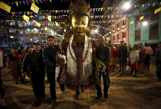 An idol of Buddha is brought in to Patan during the Samyak festival in Lalitpur, Nepal, March 11, 2016. (Photo by Navesh Chitrakar/Reuters)