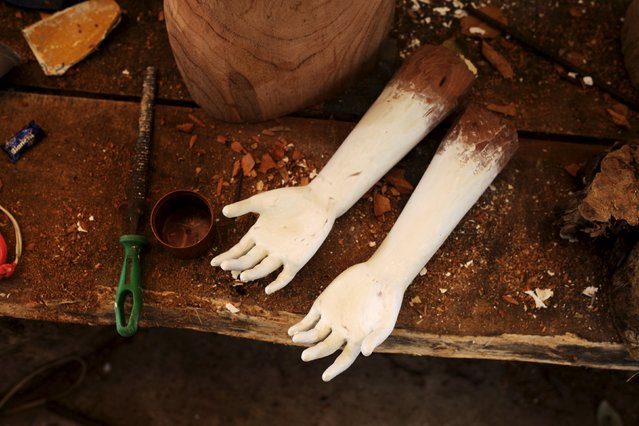 A set of wooden hands are seen at Jose Sabas Gomez's workshop in Apastepeque, El Salvador March 9, 2016. Sabas is one of a small number of artists still working on traditional religious art in El Salvador. According to him, there used to be more workshops engaged in the work of restoring statues of saints, but only four remain today as the labor-intensive craft is no longer a popular choice of profession. (Photo by Jose Cabezas/Reuters)