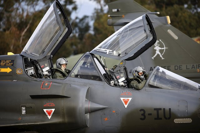 Pilots prepare to fly a Mirage 2000 fighter jet during the close air support (CAS) exercise Serpentex 2016 hosted by France in the Mediterranean island of Corsica, at Solenzara air base, March 16, 2016. (Photo by Charles Platiau/Reuters)