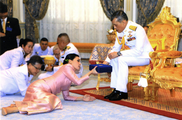 In this photo released by Bureau of the Royal Household ,Thailand's King Maha Vajiralongkorn Bodindradebayavarangkun, right, presents a gift to Queen Suthida Vajiralongkorn Na Ayudhya at Ampornsan Throne Hall in Bangkok, Thailand, Wednesday, May 1, 2019.Thailand's King Maha Vajiralongkorn, who will have his official coronation on Saturday, has appointed his consort as the country's queen. An announcement Wednesday in the Royal Gazette said Suthida Vajiralongkorn Na Ayudhya is legally married to the 66-year-old king, and is now Queen Suthida. (Photo by Bureau of the Royal Household via AP Photo)