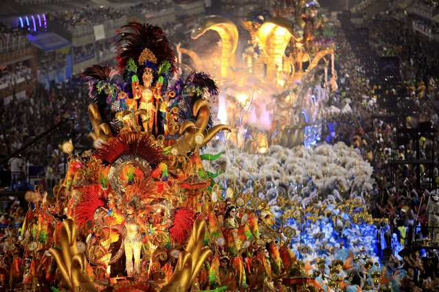 "Members of the ""Beija-Flor"" samba school perform during celebrations of the Carnival at the sambadrome in Rio de Janeiro, Brazil, 03 March 2014. (Photo by Luiz Eduardo Perez/EPA)"