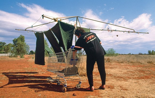 It is easy to love a sunburnt country on washing day. A man hangs his towels on the line at Leonora Motor Inn in the Leonora goldfields. (Photo by Frances Andrijich)