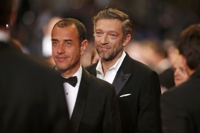 "Director Matteo Garrone (L) and cast member Vincent Cassel pose on the red carpet as they arrive for the screening of the film ""Tale of Tales"" in competition at the 68th Cannes Film Festival in Cannes, southern France, May 14, 2015. (Photo by Benoit Tessier/Reuters)"