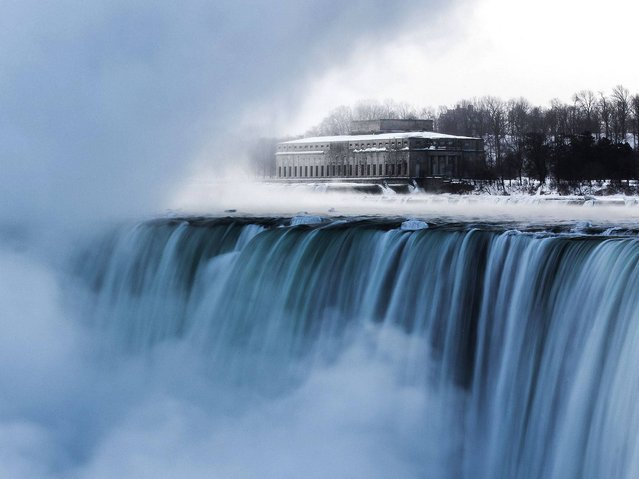 An old hydro building is seen behind Niagara Falls during sub freezing temperatures in Niagara Falls, Ontario. (Photo by Mark Blinch/Reuters)