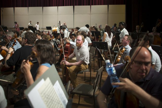 A member of the Minnesota Orchestra (C) looks to the camera during a rehearsal in Havana, May 15, 2015. (Photo by Alexandre Meneghini/Reuters)