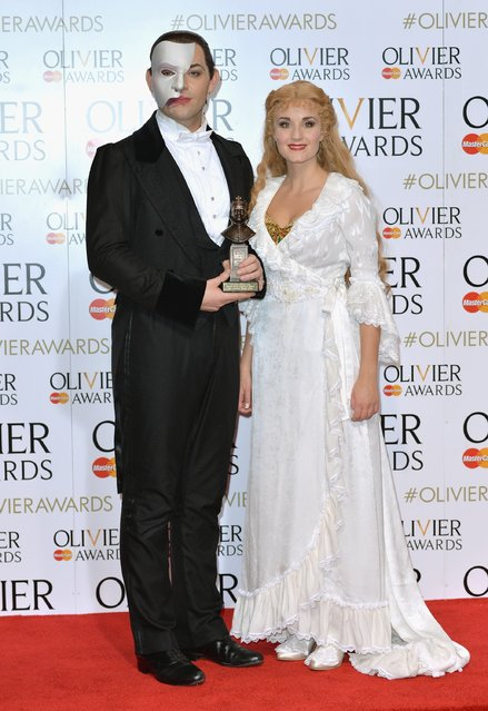 """Ben Forster and Emmi Christensson pose with the Magic Radio Audience Award for """"Phantom Of The Opera"""" in the winners room at The Olivier Awards at The Royal Opera House on April 3, 2016 in London, England. (Photo by Anthony Harvey/Getty Images)"""