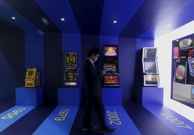 Slot machines of different generations are displayed at the Global Gaming Expo (G2E) Asia in Macau, China May 19, 2015. (Photo by Bobby Yip/Reuters)