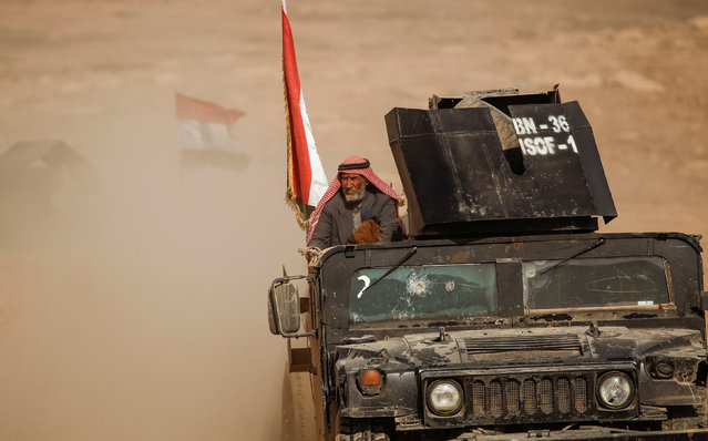 A displaced elderly Iraqi  man who just fled his home arrives on military humvee at Sepcial forces base , as Iraqi forces battle with Islamic State militants, in western Mosul, Iraq February 27, 2017. (Photo by Zohra Bensemra/Reuters)