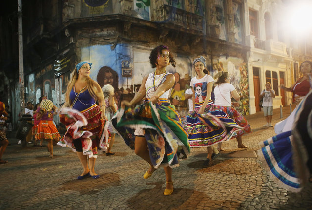 "Dancers perform on their way to attend a rally with former President Luiz Inacio Lula da Silva, ""Lula"", supporting President Dilma Rousseff in the historic Lapa neighborhood on April 11, 2016 in Rio de Janeiro, Brazil. Brazil's congressional impeachment committee approved the motion to proceed with President Dilma Rousseff's impeachment process today. A full vote by the lower house of Congress on the impeachment is scheduled for Sunday to decide whether she will face trial. (Photo by Mario Tama/Getty Images)"