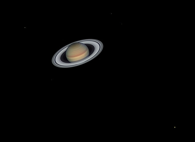 The Lord of the rings and his court. Jordi Delpeix Borrell (Spain). The image showcases Saturn's bright rings and satellites. Titan is at the bottom right, Rhea on the top left, Tethys and Dione to the right of the planet and Enceladus and Mimas under the rings. Saturn's tilt is cyclical and reaches maximum inclination every 15 years. The maximum tilt toward the Earth was in 2017. (Photo by Jordi Delpeix Borrell/National Maritime Museum)