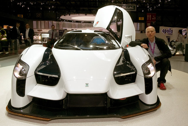 American Ferrari collector Jim Glickenhaus poses beside an 800 horsepower SCG 0003S during the 87th International Motor Show at Palexpo in Geneva, Switzerland March 8, 2017. (Photo by Arnd Wiegmann/Reuters)