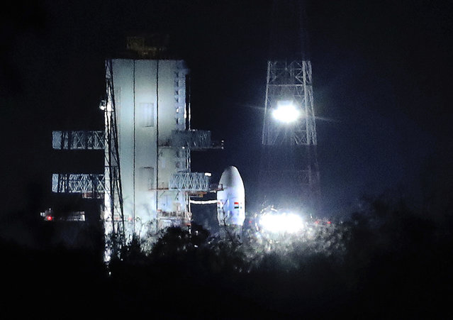 """Indian Space Research Organization (ISRO)'s Geosynchronous Satellite launch Vehicle (GSLV) MkIII carrying Chandrayaan-2 stands at Satish Dhawan Space Center after the mission was aborted at the last minute at Sriharikota, in southern India, Monday, July 15, 2019. India has called off the launch of a moon mission to explore the lunar south pole. The Chandrayaan-2 mission was aborted less than an hour before takeoff on Monday. An Indian Space Research Organization spokesman says a """"technical snag"""" was observed in the 640-ton launch-vehicle system. (Photo by Manish Swarup/AP Photo)"""