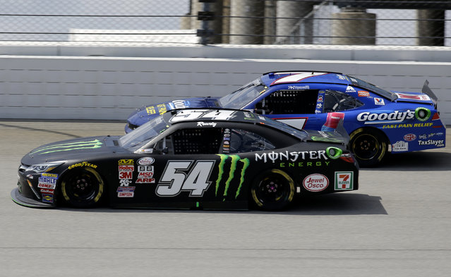 Erik Jones (54) drives past Regan Smith (7) during the NASCAR Xfinity series auto race at Chicagoland Speedway, Sunday, June 21, 2015, in Joliet, Ill. (AP Photo/Nam Y. Huh)