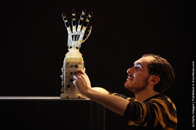 Robotics student Gildo Andreoni works on a Dexmart robotic hand built at the University of Bologna in the Robotville exhibition at the Science Museum