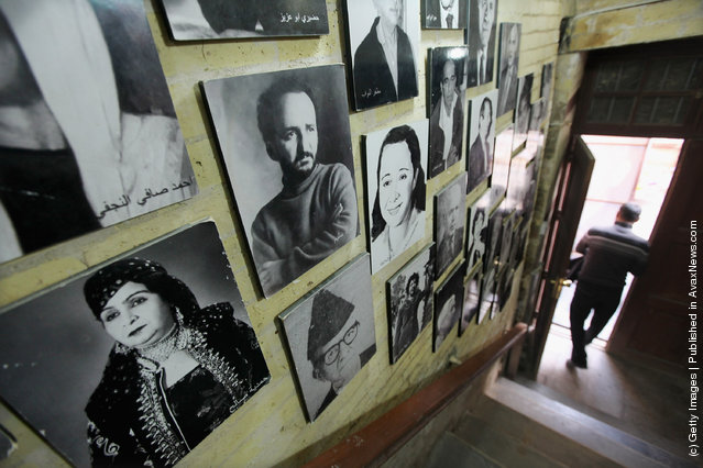 Portraits of famous Iraqis are seen in the stairwell of a bookshop
