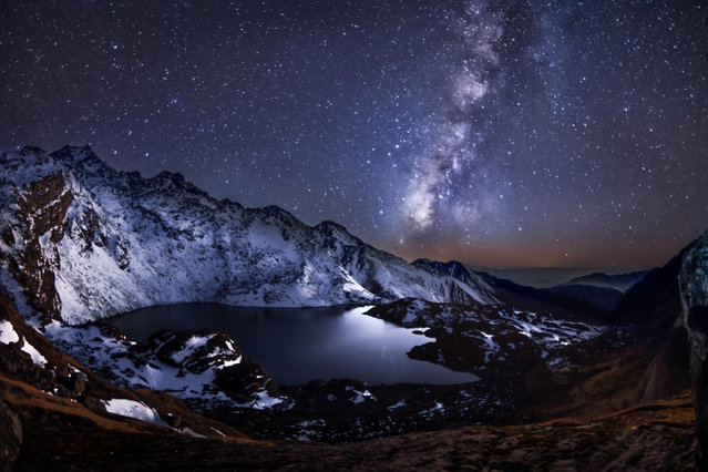 Calmness of Eternity by Yevhen Samuchenko was taken in the Himalayas in Nepal at Gosaikunda lake at 4,400m. The Milky Way is the galaxy containing our solar system, with the name describing the galaxy's appearance from Earth: a hazy band of light seen in the night sky formed from stars that cannot be individually distinguished by the naked eye. (Photo by Yevhen Samuchenko/2019 Science Photographer of the Year/RPS)