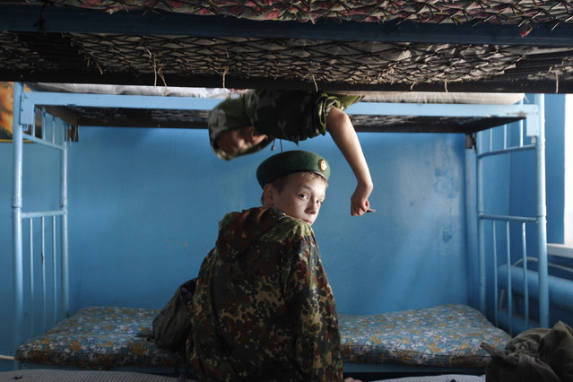 Students from the General Yermolov Cadet School sit on bunk beds during a two-day field exercise near the village of Sengileyevskoye, just outside the south Russian city of Stavropol April 12, 2014. (Photo by Eduard Korniyenko/Reuters)