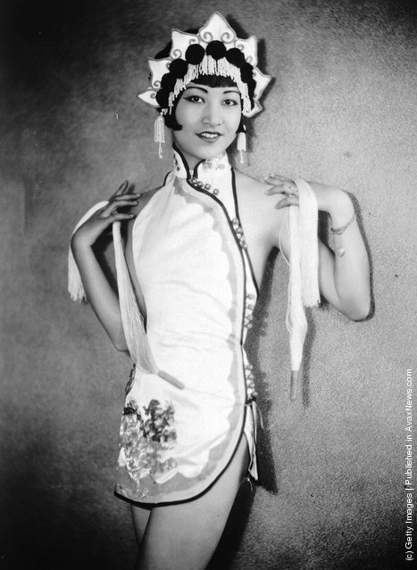 1935: American-Chinese actress Anna May Wong (1907 - 1961) wearing an Oriental-style costume and headdress