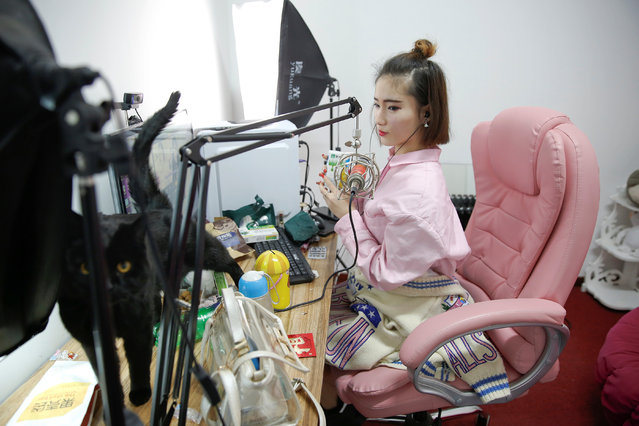 A girl broadcasts at live streaming talent agency Three Minute TV in Beijing, China on April 12, 2017. Three Minute TV also arranges cosmetic surgery at partner hospitals for its anchors, arranges small bank loans for the surgery, photographs and markets the anchors and helps them find acting opportunities Deng said. (Photo by Damir Sagolj/Reuters)