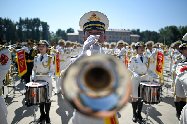 A member of Chinese military band performs at a camp during a tour arranged for media by the press centre in charge of celebrating the 70th anniversary of the country's founding, on the outskirts of Beijing, China on September 25, 2019. (Photo by Wang Zhao/Pool via Reuter)