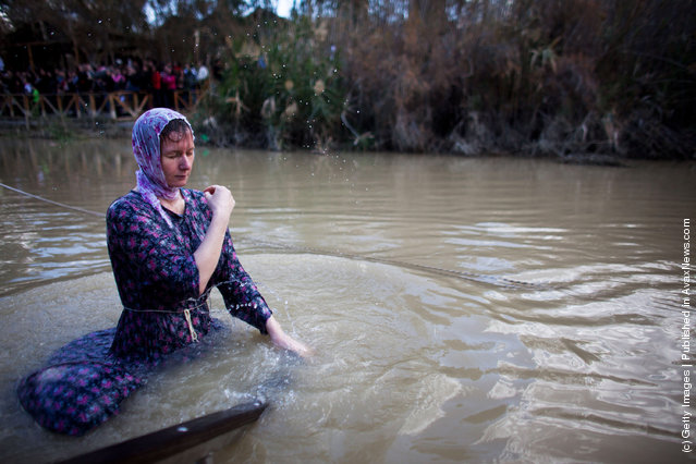 Orthodox Christian pilgrims are baptized during Epiphany celebrations in the Jordan River