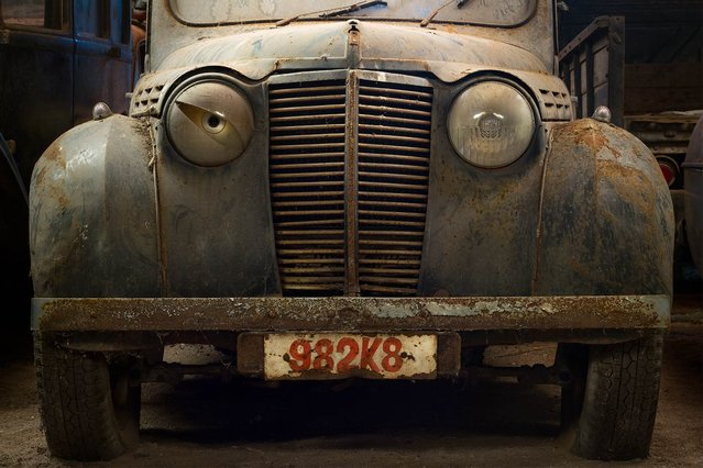 A old car, sad and lost in a garage somewhere in Belgium. Quietly waiting for its owner to come visit, hoping to be restored to its original state. (Photo by Vincent Jansen)