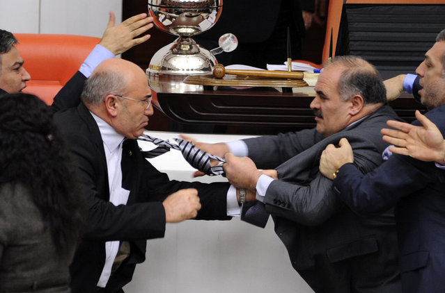 Turkey's ruling AK Party lawmaker Muhittin Aksak (R) and main opposition Republican People's Party lawmaker Mahmut Tanal scuffle during a debate at the parliament in Ankara, February 8, 2012. (Photo by Reuters/Stringer)