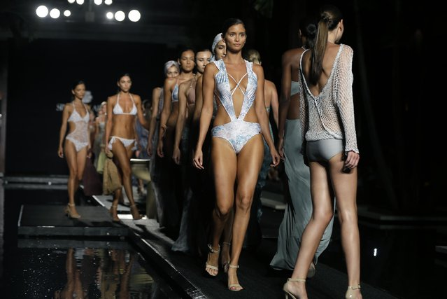 Models walk down the runway during the Sinesia Karol swimwear show as part of Funkshion Fashion Week Swim, Friday, July 17, 2015, in Miami Beach, Fla. (Photo by Lynne Sladky/AP Photo)