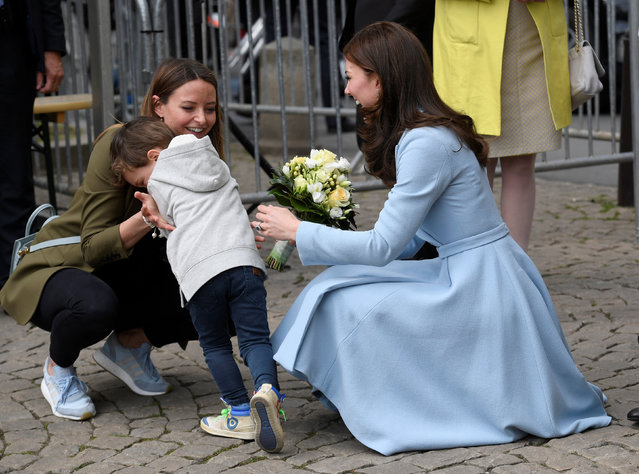 A young boy reacts after he handed a bouquet of flowers to Britain's Catherine, the Duchess of Cambridge in Luxembourg, May 11, 2017. (Photo by Toby Melville/Reuters)