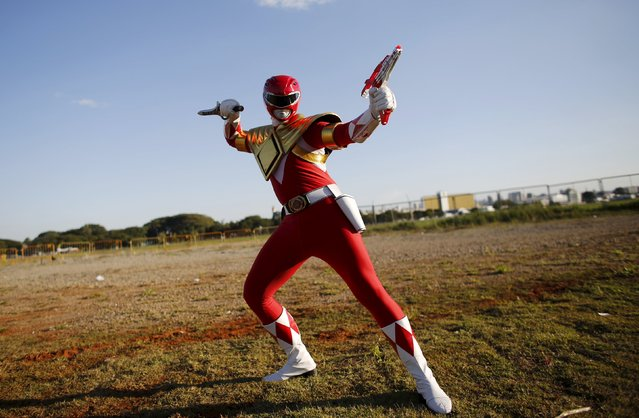 "A cosplay enthusiast poses as Red Ranger of the Power Rangers anime series during the ""Anime Friends"" annual event in Sao Paulo July 19, 2015. (Photo by Nacho Doce/Reuters)"
