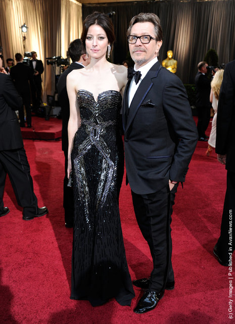 Actor Gary Oldman (R) and Alexandra Edenborough arrive at the 84th Annual Academy Awards held at the Hollywood & Highland Center