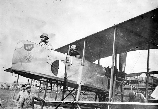 Captain Maurice Happe, rear seat, commander of French squadron MF 29, seated in his Farman MF.11 Shorthorn bomber with a Captain Berthaut. The plane bears the insignia of the first unit, a Croix de Guerre, ca. 1915. (Photo by Library of Congress via The Atlantic)