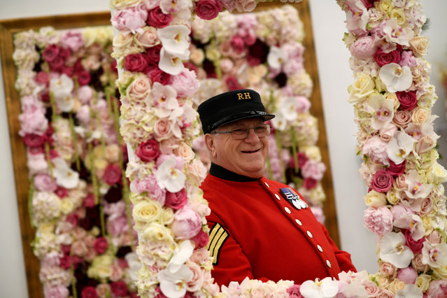 A Chelsea Pensioner looks at a display at the Royal Horticultural Society's Chelsea Flower show in London, Britain, May 22, 2017. (Photo by Neil Hall/Reuters)
