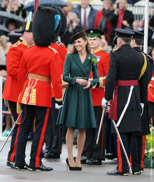 Catherine, Duchess of Cambridge presents shamrocks to members of the 1st Battalion Irish Guards at the St Patrick's Day Parade at Mons Barracks