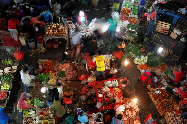 People shop in the early morning at a wet market in Jakarta, Indonesia May 24, 2016. (Photo by Iqro Rinaldi/Reuters)