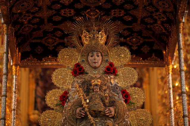 The Virgin of El Rocio is seen on an altar during a pilgrimage inside the shrine of El Rocio in Almonte, southern Spain June 2, 2017. (Photo by Jon Nazca/Reuters)