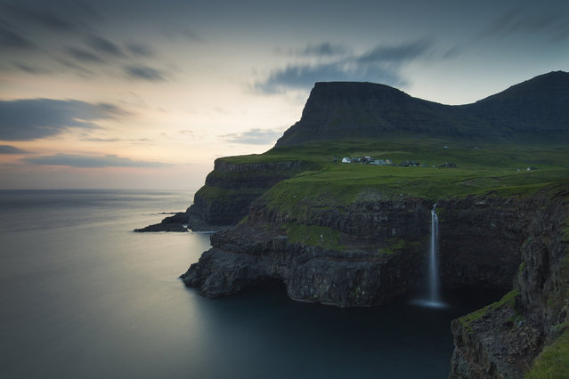 """Gásadalur"". I first visited the small village of Gásadalur in the Faroe Islands some twenty years ago, when it was accessible only by boat or, as I did, by walking over the surrounding mountains. Today the once secluded village can be reached by car and I used the opportunity to revisit this picture perfect part of the world. Photo location: Gásadalur, Faroe Islands. (Photo and caption by Hans Juul Hansen/National Geographic Photo Contest)"