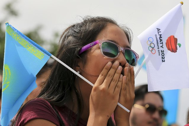 A woman reacts as she watches the Olympic vote in Almaty, Kazakhstan, Friday, July 31, 2015. Beijing has been selected to host the 2022 Winter Olympics, becoming the first city awarded both the winter and summer games. Beijing defeated Almaty, Kazakhstan, in a vote of the International Olympic Committee on Friday. (Photo by Pavel Mikheyev/AP Photo)