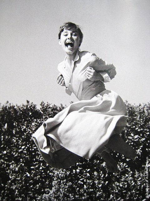 British actress and humanitarian Audrey Hepburn, 1955. Jumpology