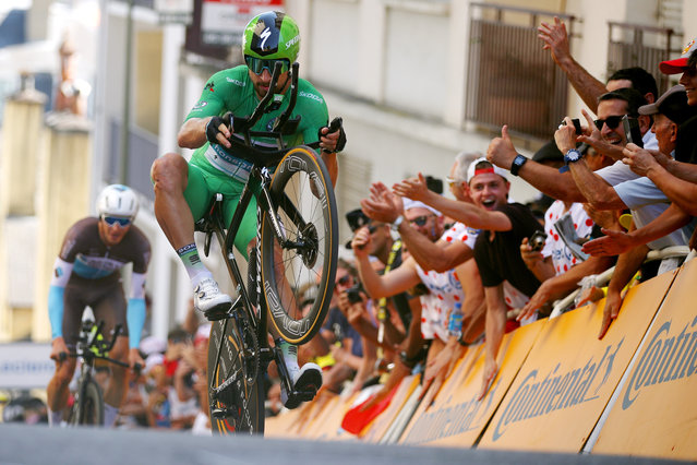 "Peter Sagan of Slovakia and Team Bora-Hansgrohe does a ""wheelie"" during the individual time trial stage 13 in Pau, France on July 19, 2019. (Photo by Chris Graythen/Getty Images)"