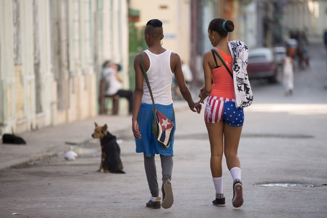 A couple who did not give their names walk in downtown Havana, February 2, 2015. (Photo by Alexandre Meneghini/Reuters)