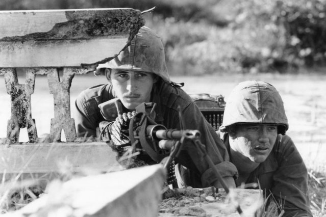Spec. 4 James D. McClafferty of Philadelphia and Pfc. Ted Talley of Marked Tree, Ark., man a machine gun in the ruins of a house near Rach Kien, 22 miles southwest of Saigon, Jan. 2, 1966