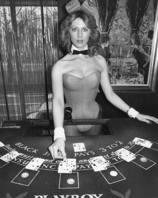 Croupier and bunny girl, Corrina, dealing cards at the Hefner-Playboy Park Lane club in London, 16th February 1978. (Photo by Ian Tyas/Keystone Features/Getty Images)