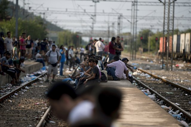 Migrants wait for a train at Gevgelija train station in Macedonia, close to the border with Greece, August 14, 2015. (Photo by Stoyan Nenov/Reuters)