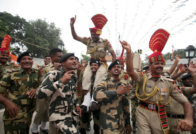 Indian Border Security Force (BSF) soldiers dance during India's Independence Day celebrations at the India-Pakistan joint check post at the Wagah border on the outskirts of Amritsar, India, August 15, 2015. (Photo by Munish Sharma/Reuters)