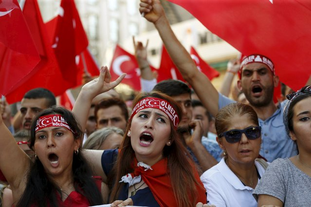 Demonstrators shout nationalist slogans during a protest against Kurdistan Workers' Party (PKK) in central Istanbul, Turkey, August 16, 2015. A Turkish soldier and three Kurdish militants were killed in a clash in eastern Turkey on Sunday, security sources said. The fighting between Turkish special forces and the outlawed PKK took place in a rural area of Kars province, they said. (Photo by Murad Sezer/Reuters)