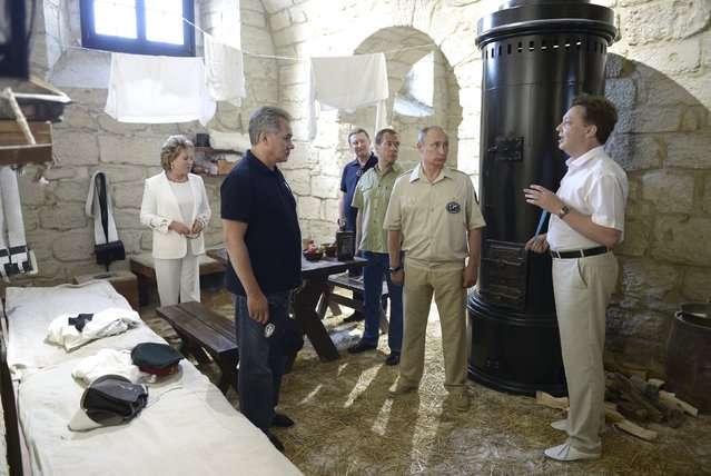Russian President Vladimir Putin (2nd R), accompanied by Prime Minister Dmitry Medvedev (3rd R),  head of the presidential administration Sergei Ivanov (3rd L), Federation Council Speaker Valentina Matviyenko (L, back) and Sergei Shoigu (L, front), visits the restored historical Konstantinovskaya casemated battery, a fortified cannon position for guarding the bay, in Sevastopol, Crimea, August 18, 2015. (Photo by Alexei Nikolsky/Reuters/RIA Novosti/Kremlin)